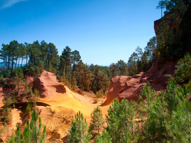 The Vivid Red Ocher Cliffs In Roussillon, France Stock Photo