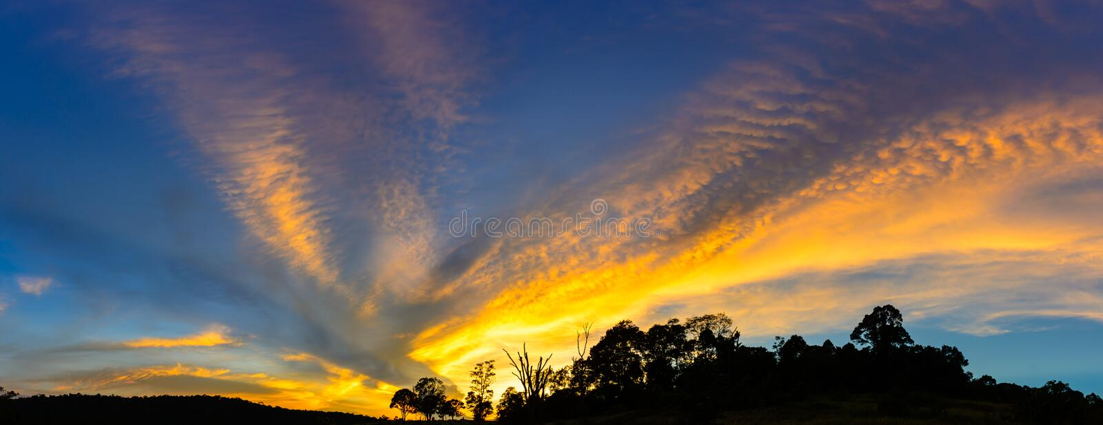 Vivid stormy sky at sunset in Thailand royalty free stock photography