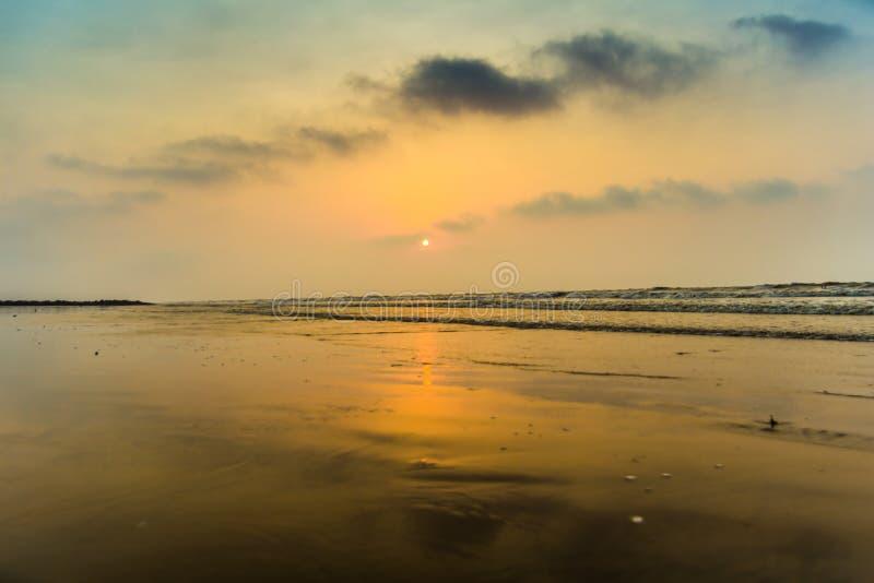 Vivid sunrise on a serene calm tranquil deserted beach at digha puri mandarmanivivid sunrise on a serene calm tranquil deserted be royalty free stock photography
