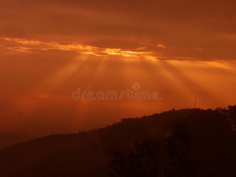 Vivid sunset colors and clouds India stock images