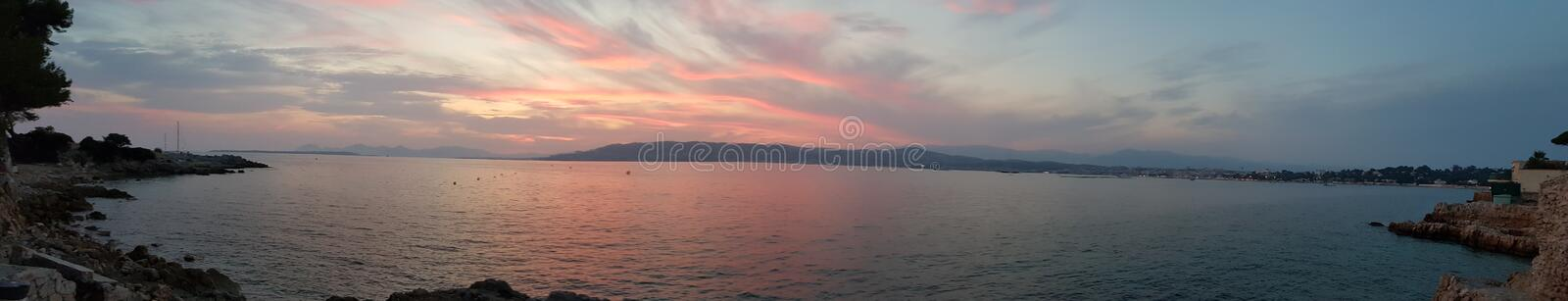 Vivid sunset with purple sky royalty free stock photography
