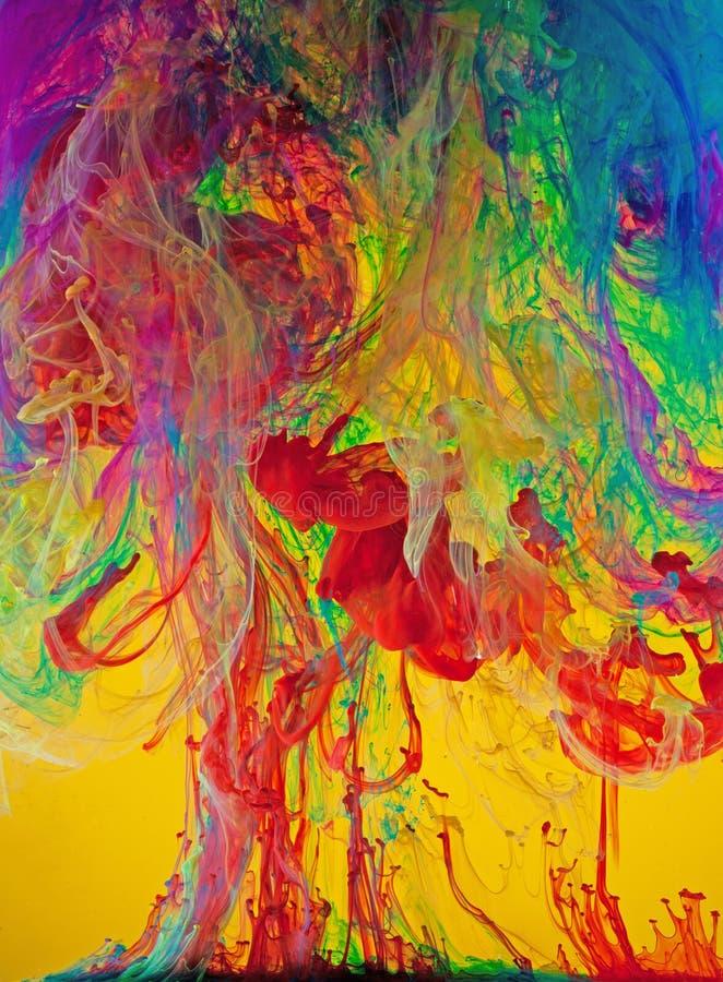 Vivid Swirls of Liquid Paints. Vivid, colorful liquid paints floating in fluid stock images