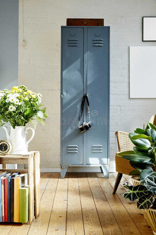 Vivid vintage apartment metal locker plants and sun light royalty free stock photography