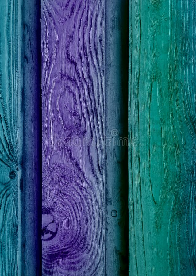 Vivid weathered old wooden planks texture background with natural wood structure painted in unusual psychedelic teal and stock image