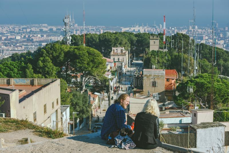 Viw from Bunkers del Carmel panorama, Barcelona. BARCELONA, SPAIN - DECEMBER 26, 2015: People watching panorama of Barcelona form the hill known as the `Turo de royalty free stock image