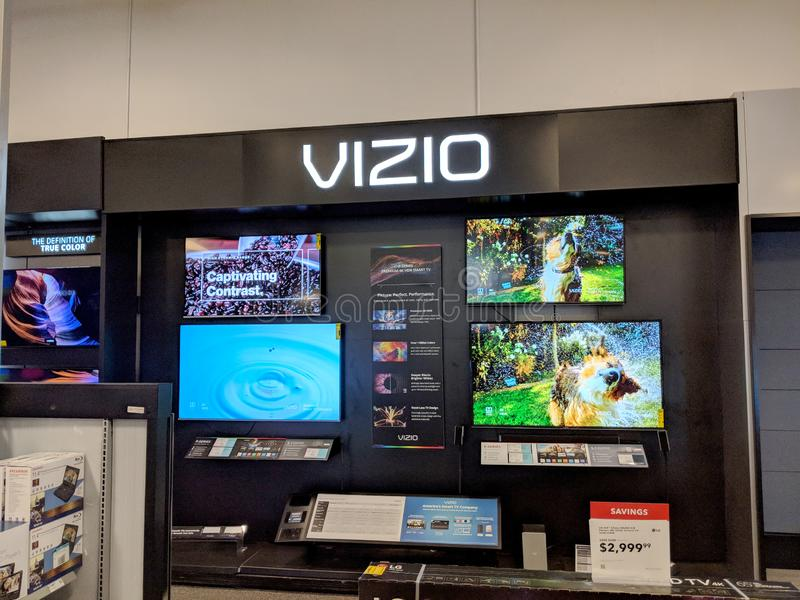 Vizio TV Display with Dog shaking inside Best Buy. Honolulu - August 10 2018: Vizio TV Display with Dog shaking inside Best Buy. VIZIO is the maker of the top stock images