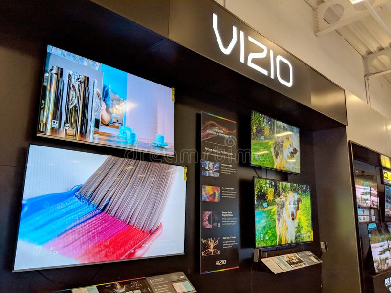 Vizio TV Display with Paint brush and Dog shaking on screens inside Best Buy. Honolulu - August 10 2018: Vizio TV Display with Paint brush and Dog shaking on royalty free stock photo