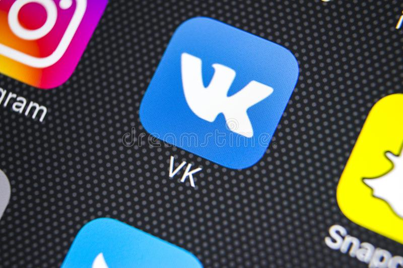 Vkontakte application icon on Apple iPhone X screen close-up. VK app icon. Vkontakte mobile application. Social media network. Sankt-Petersburg, Russia, March royalty free stock images