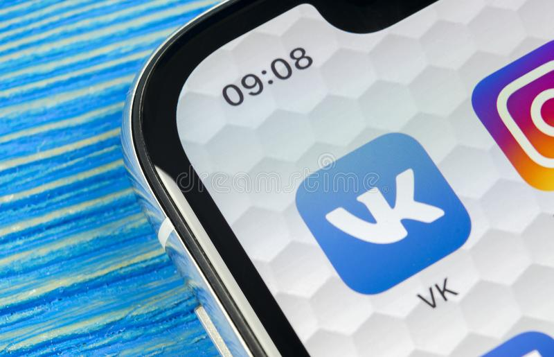 Vkontakte application icon on Apple iPhone X screen close-up. VK app icon. Vkontakte mobile application. Social media network. Soc. Sankt-Petersburg, Russia royalty free stock photo