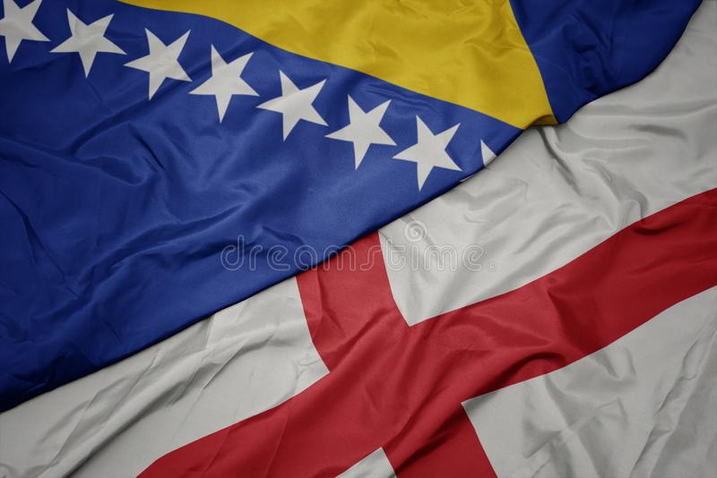 vlaag van engeland en nationale vlag van bosnië en herzegovina met een kleurrijke vlag royalty-vrije stock afbeeldingen