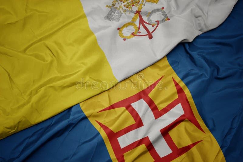 vlaag van madeira en vaticaanstad met een kleurrijke vlag stock afbeelding