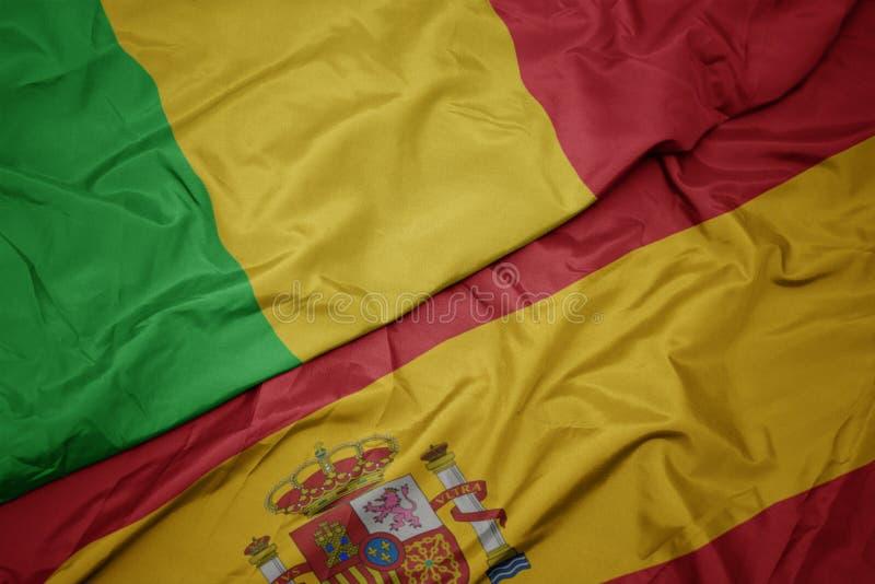 vlaag van spanje en nationale vlag van mali royalty-vrije stock afbeelding