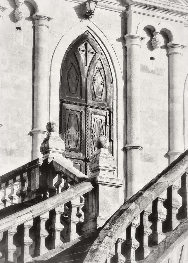Vladimir church in Bykovo.Moskovskaya area. wrought iron gates to the castle temple stock photography