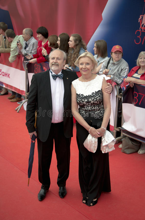 Vladimir Khotinenko with his wife on the red carpet before the opening 37 of the Moscow International film Festival stock images