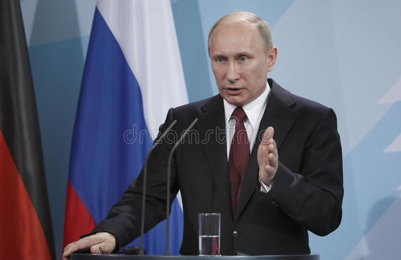 Vladimir Putin. Russian President Vladimir Putin addresses the media after talks with German Chancellor Angela Merkel at the chancellery in Berlin, Germany stock image