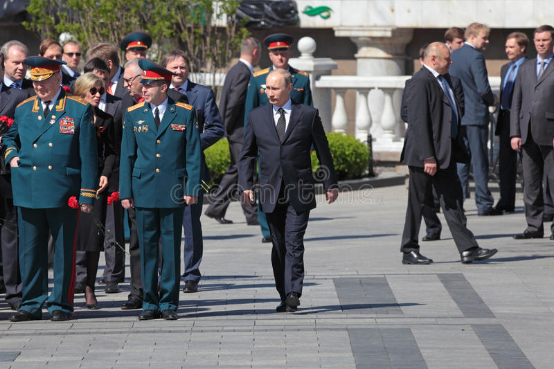 Vladimir Putin. MOSCOW - MAY 8: Vladimir Putin at the ceremony of laying wreaths to the Tomb of the Unknown Soldier in Alexander Garden. Festive events dedicated stock images