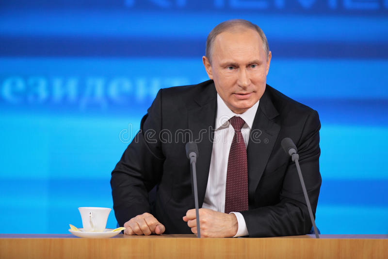 Vladimir Putin. MOSCOW, RUSSIA - DEC 19,2013: The President of the Russian Federation Vladimir Vladimirovich Putin annual press conference in Center of stock images