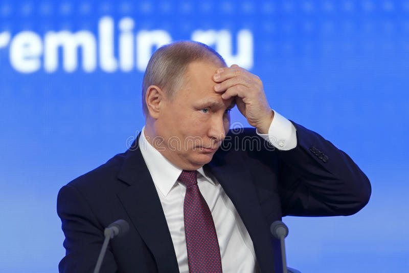 Vladimir Putin. MOSCOW, RUSSIA - DEC 23, 2016: The President of the Russian Federation Vladimir Vladimirovich Putin with eyes closed at the annual press stock photos