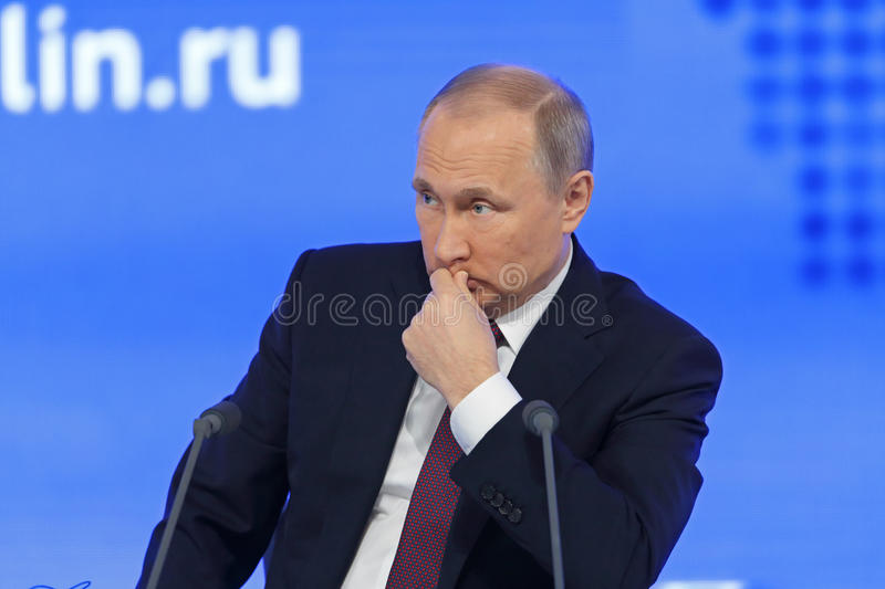 Vladimir Putin. MOSCOW, RUSSIA - DEC 23, 2016: The President of the Russian Federation Vladimir Vladimirovich Putin with eyes closed at the annual press royalty free stock photo