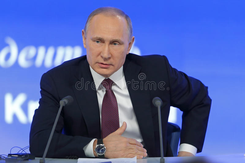 Vladimir Putin. MOSCOW, RUSSIA - DEC 23, 2016: The President of the Russian Federation Vladimir Vladimirovich Putin with eyes closed at the annual press stock images