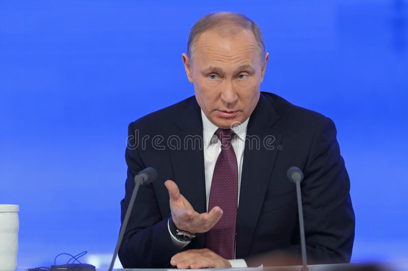 Vladimir Putin. MOSCOW, RUSSIA - DEC 23, 2016: The President of the Russian Federation Vladimir Vladimirovich Putin with eyes closed at the annual press stock photo