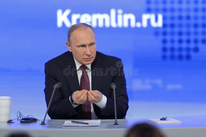 Vladimir Putin. MOSCOW, RUSSIA - DEC 23, 2016: The President of the Russian Federation Vladimir Vladimirovich Putin with eyes closed at the annual press royalty free stock image