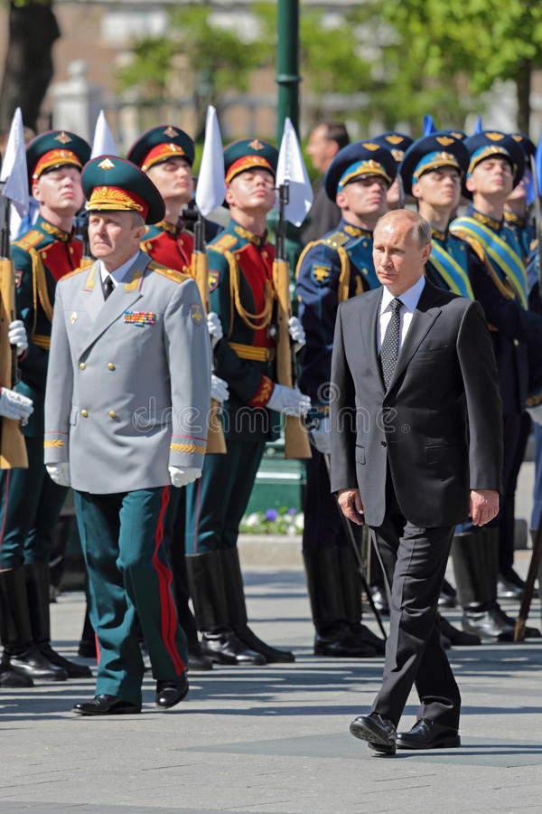 Vladimir Putin. MOSCOW, RUSSIA - MAY 8, 2014: Vladimir Putin at the ceremony of laying flowers to the Tomb of the Unknown Soldier. Festive events dedicated to stock photography