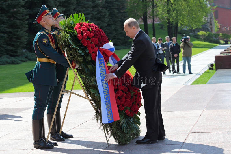 Vladimir Putin. MOSCOW, RUSSIA - MAY 8, 2014: Vladimir Putin at the ceremony of laying flowers to the Tomb of the Unknown Soldier. Festive events dedicated to stock image