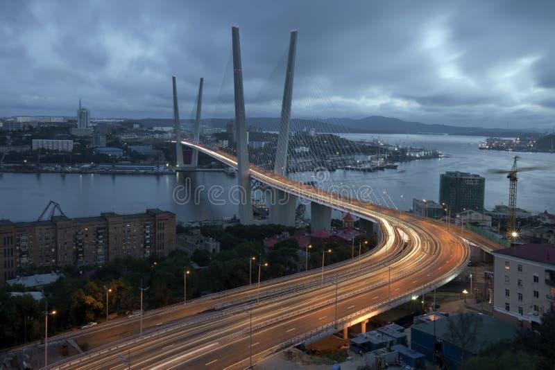 Vladivostok. Night view of the bridge in the Russian Vladivostok on the Golden Horn royalty free stock photo