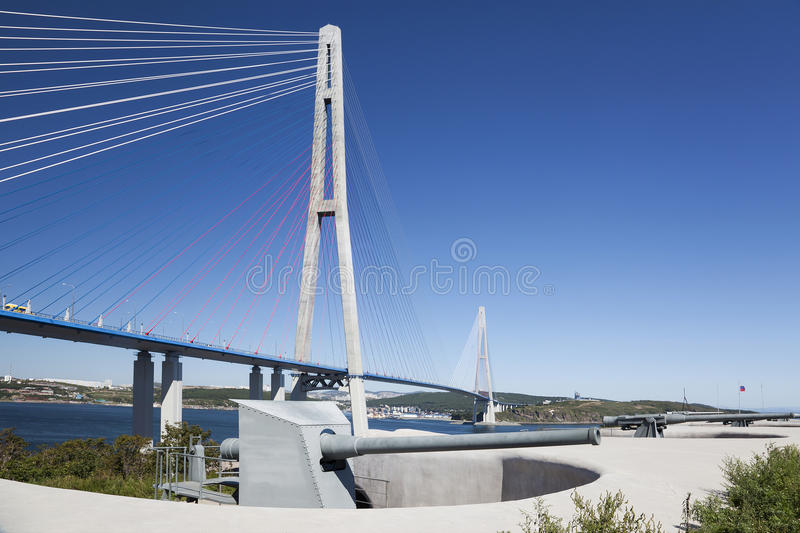 Vladivostok, Bridge Russky through the Strait of Eastern Bosphorus and coastal battery on the island of Russian. A Museum dedicated to the naval history of royalty free stock photography