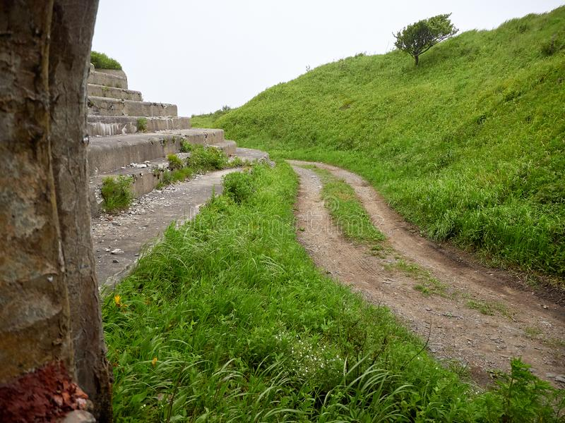 Fort of Vladivostok fortress. Vladivostok fortress Fort overgrown with greenery royalty free stock photos