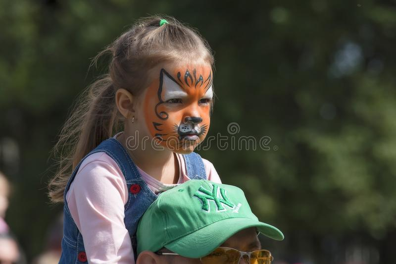 girl disguised as a tiger cub stock photography