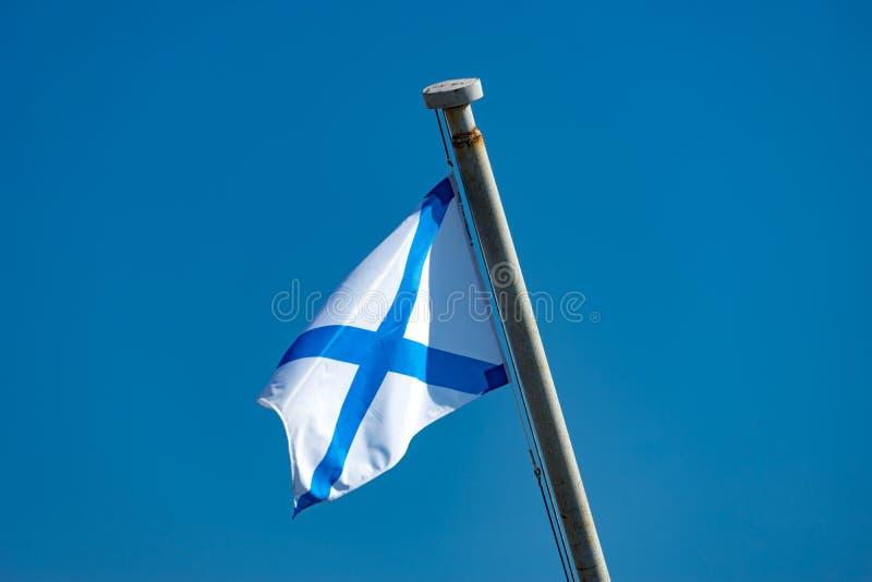Naval flag on blue sky background. stock photo