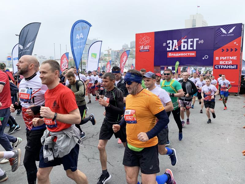 Vladivostok, Russia, May, 19, 2019. People participate in the all-Russian half marathon `Race. Russian Federation` in Vladivostok. Vladivostok, Russia. People royalty free stock photo