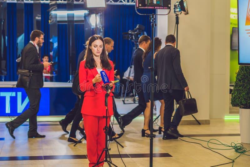 Vladivostok, Russia - September 7, 2017: Russian journalist preparing for broadcast stock images