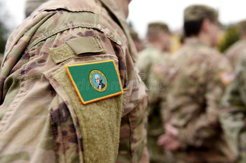 Vlag bij de staat Washington op militair uniform Verenigde Staten VS, leger, soldaten Collage stock afbeeldingen