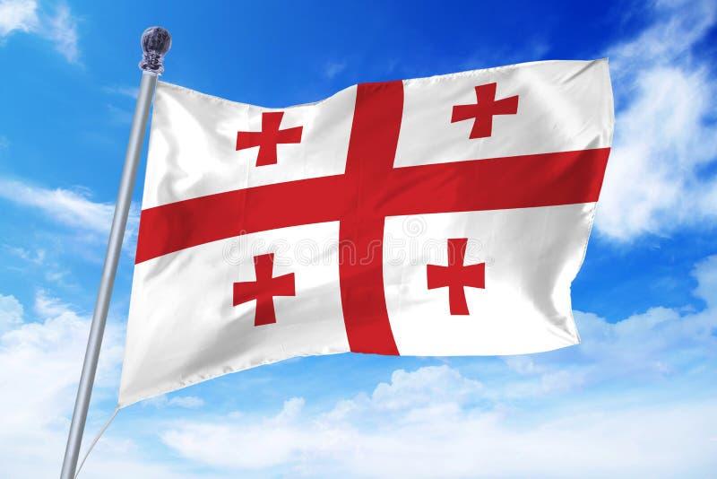 Vlag die van Georgië zich tegen een blauwe hemel ontwikkelen stock fotografie