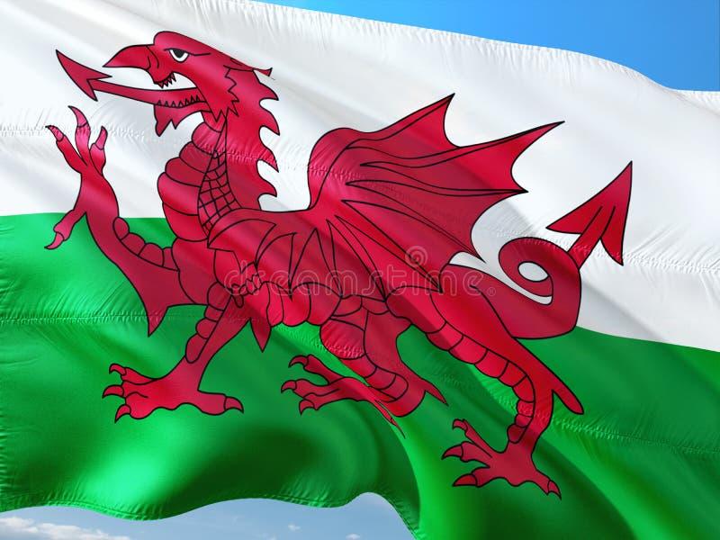 Vlag die van Wales - Galler in de wind tegen diepe blauwe hemel golven Hoog - kwaliteitsstof royalty-vrije stock foto's