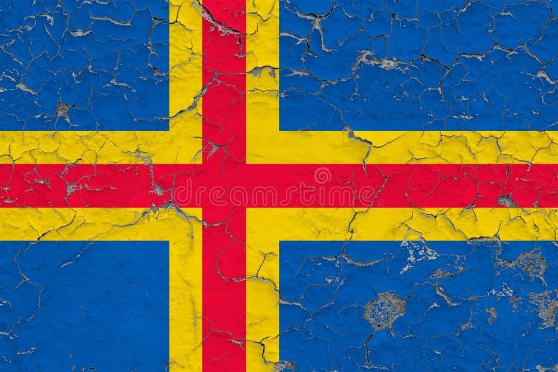 Vlag van Aland-Eilanden die op gebarsten vuile muur worden geschilderd Nationaal patroon op uitstekende stijloppervlakte royalty-vrije stock afbeeldingen