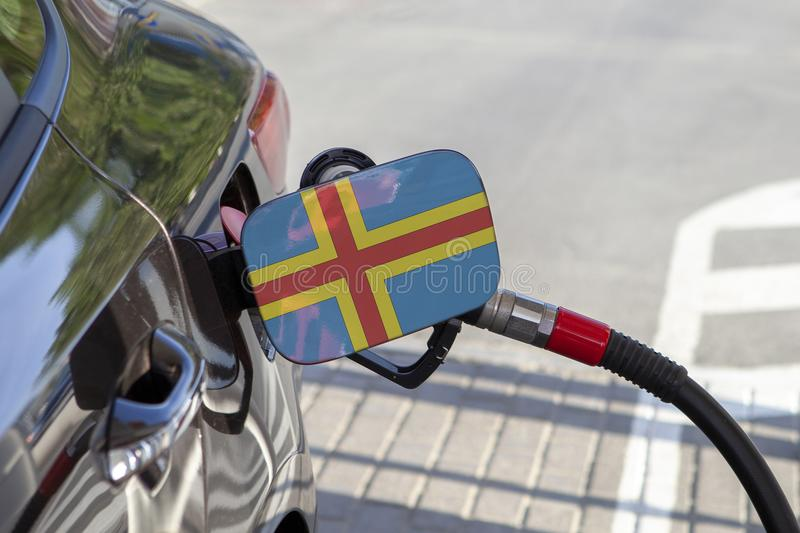 Vlag van Aland-Eilanden op de de vullerklep van de auto` s brandstof royalty-vrije stock afbeeldingen