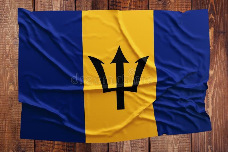 Vlag van Barbados op een houten lijstachtergrond Gerimpelde vlag hoogste mening Van Barbados stock fotografie