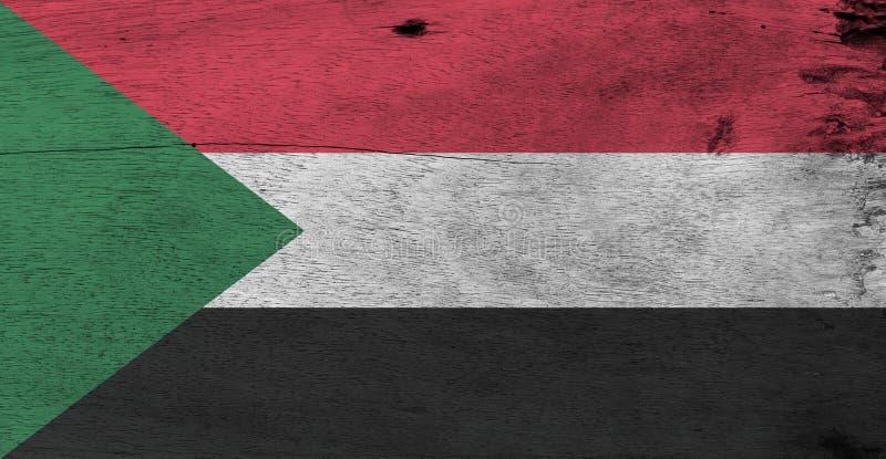 Vlag van de Soedan op houten plaatachtergrond De vlagtextuur van de Grungesoedan royalty-vrije stock foto's