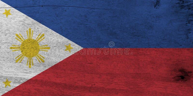 Vlag van Filippijnen op houten plaatachtergrond De vlagtextuur van Grungefilippijnen stock foto's