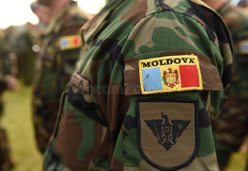Vlag van het het leger de eenvormige flard van Moldavië Moldovisch Leger stock foto