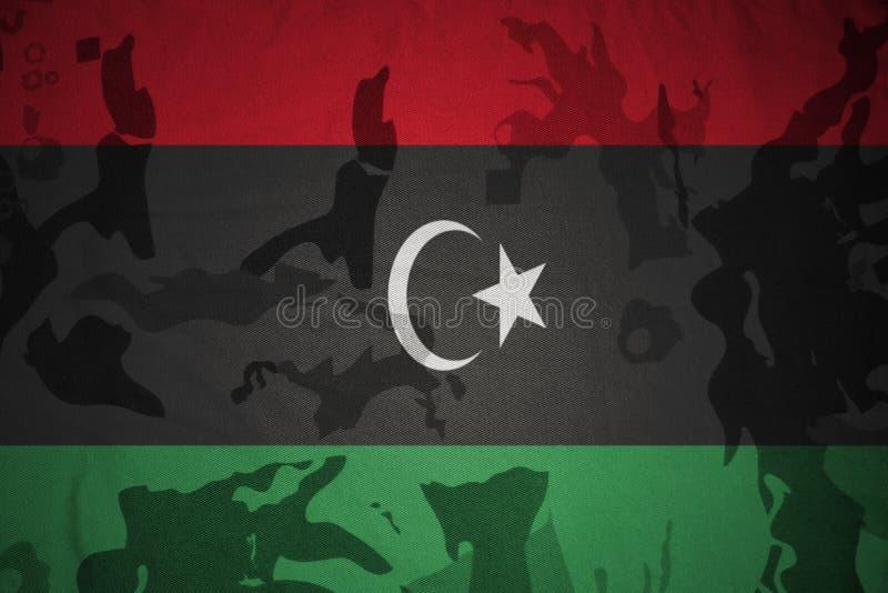 vlag van Libië op de kaki textuur Militair concept royalty-vrije stock fotografie