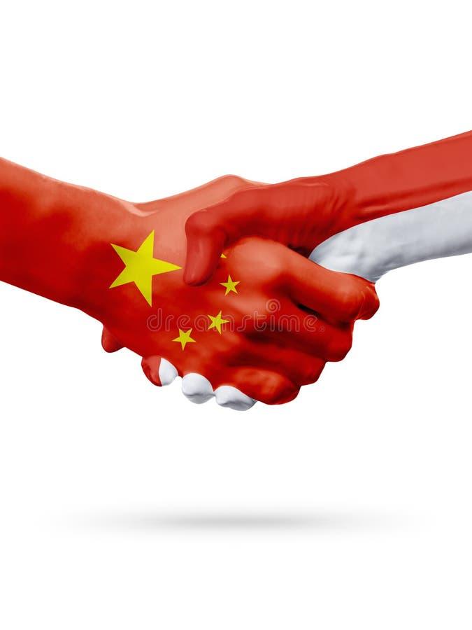 Vlaggen China, de landen van Monaco, de handdrukconcept van de vennootschapvriendschap royalty-vrije stock afbeeldingen