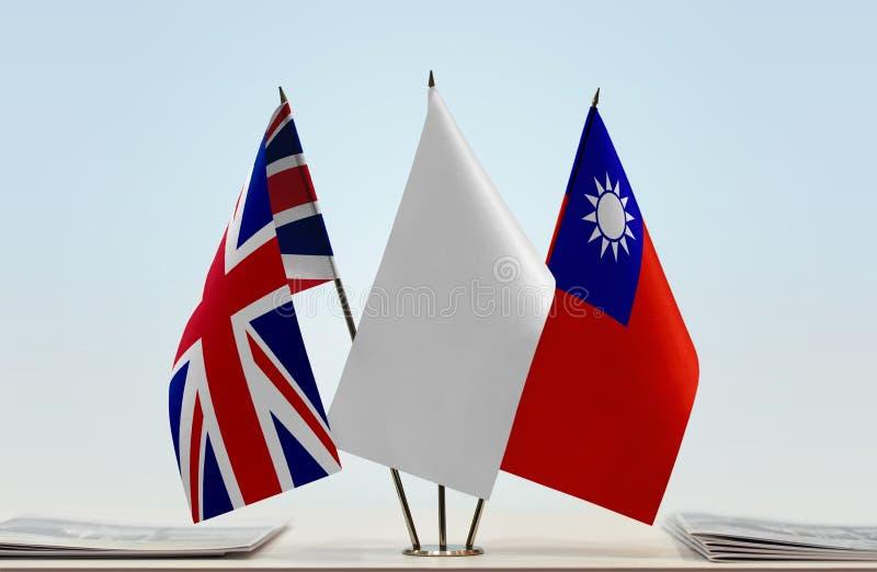 Vlaggen van Groot-Brittannië en Taiwan stock afbeelding