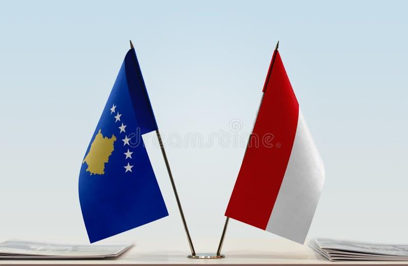 Vlaggen van Kosovo en Monaco stock fotografie