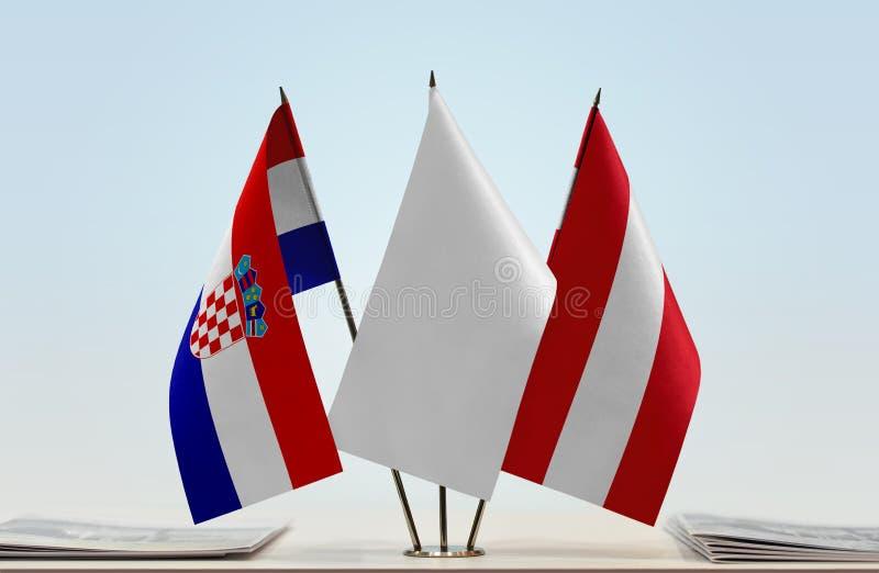 Vlaggen van Kroatië en Oostenrijk stock afbeeldingen