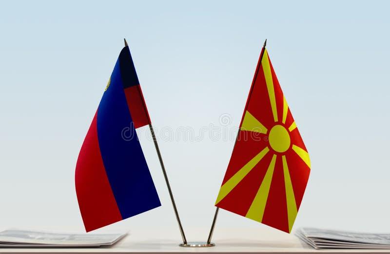 Vlaggen van Liechtenstein en Republiek Noord-Macedonië FYROM stock afbeelding